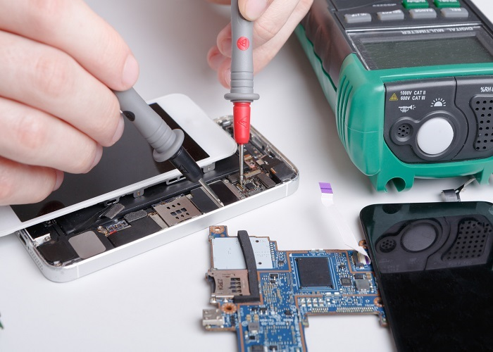 Repairing smartphone with multimeter close up